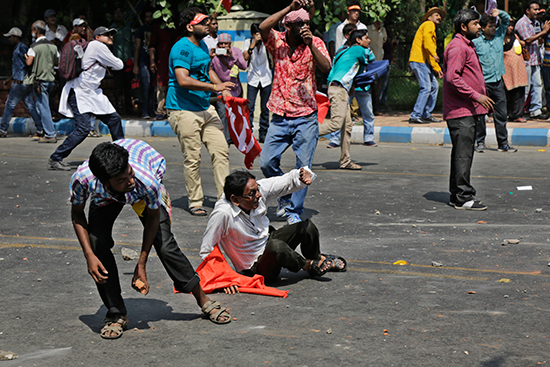 Protesters battle police in Kolkata, India, May 22, 2017. Dozens of journalists were injured as police forcibly cleared demonstrations. (AP/Bikas Das)