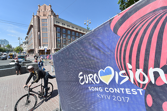 A cyclist passes a poster in Kiev for the Eurovision song content. Ukraine expelled three Russian journalists who traveled to Kiev for the annual event. (AFP/Sergei Supinsky)