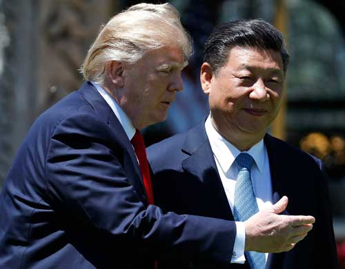 U.S. President Donald Trump and Chinese President Xi Jinping walk together after their meetings at Mar-a-Lago in Palm Beach, Florida, on April 7, 2017. (AP/Alex Brandon)