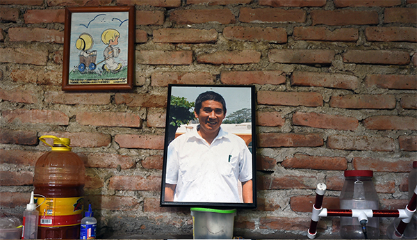 A portrait of Moises Sánchez is seen at the Medellin home of his son in August 2015. The Veracruz journalist, known for his critical coverage of local authorities, was abducted and murdered in January 2015. (AFP/Alfredo Estrella)