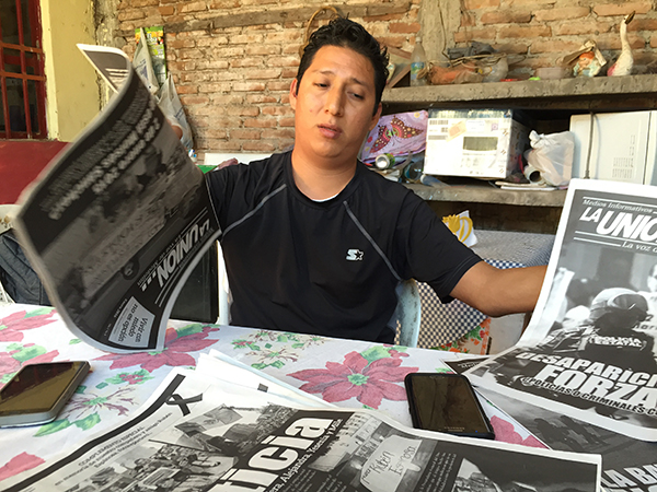 Jorge Sánchez displays copies of his father's paper, La Union, at his home in January 2017. After Moises Sánchez's murder, Jorge took over the running of the paper. (CPJ/Miguel Ángel Díaz)