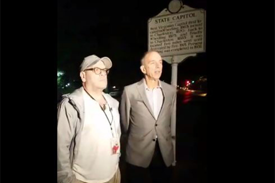 In an image created from video from the American Civil Liberties Union of West Virginia's Facebook page, Dan Heyman, left, addresses the press after his release in Charleston, West Virginia, May 9, 2017.