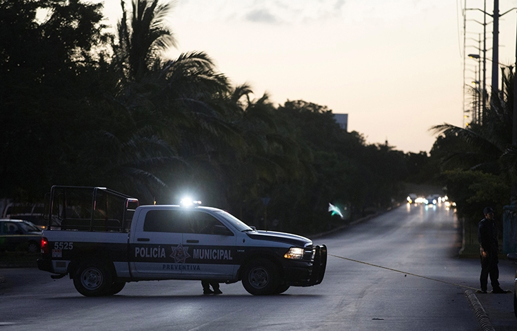 In this file photo, municipal police block a street in Cancun, Quintana Roo, Mexico, January 17, 2017. (Reuters/Victor Ruiz Garcia)