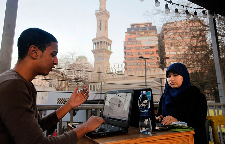 In this file photo, Egyptians access the internet at a community center in Cairo, February 9, 2013. (AP/Amr Nabil)