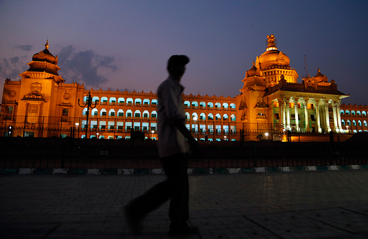 A man walks in front of the seat of the Karnataka state legislature in Bangalore, India, April 2, 2017. (AP/Aijaz Rahi)