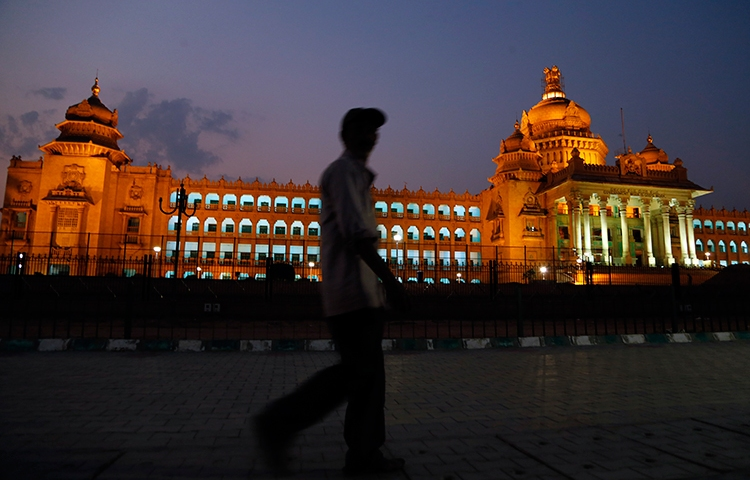 A man walks in front of the seat of the Karnataka state legislature in Bangalore, India, April 2, 2017. (AP/Aijaz Rahi)
