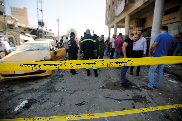 Police tape cordons off the site of a car bomb attack in Baghdad, May 30, 2017. (Reuters/Khalid Al-Mousily)