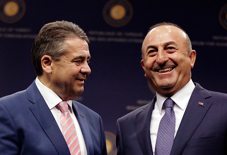 Turkish Foreign Minister Mevlüt Çavuşoğlu (right) and German Foreign Minister Sigmar Gabriel pose after a press conference in Ankara, June 5, 2017. (AP/Burhan Ozbilici)