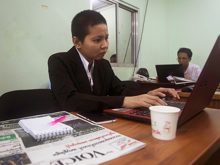 Journalists work in The Voice's office in Yangon, Myanmar, June 5, 2017. (AP/Thein Zaw)