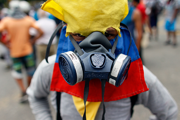 A protester poses in Caracas, June 14, 2017. (AP/Ariana Cubillos)