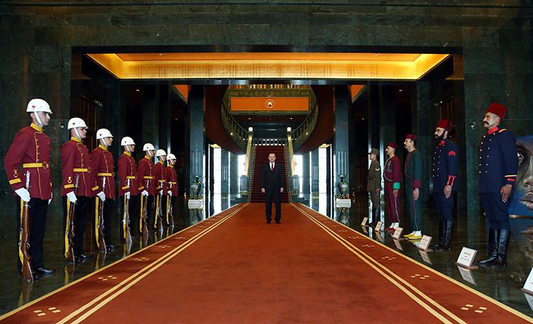 Turkish President Recep Tayyip Erdoğan stands in the presidential palace in Ankara, June 15, 2017. (AP/Presidency Press Service)