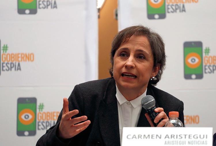 Mexican investigative journalist Carmen Aristegui speaks to reporters in Mexico City, June 19, 2017. (AP/Eduardo Verdugo)