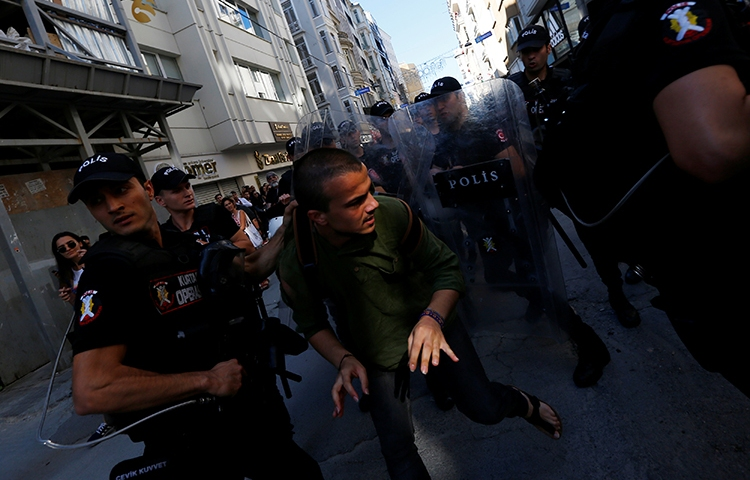 Police disperse marchers who had tried to gather for an LGBTQI pride march in Istanbul, June 25, 2017. Police also briefly detained an AP reporter (not pictured here) at the march, according to reports. (Reuters/Murad Sezer)