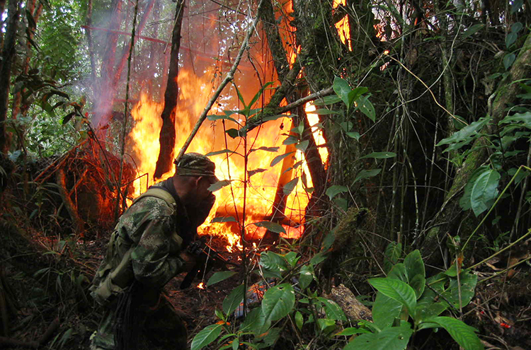 A soldier destroys chemicals used in the production of cocaine in Ragondalia, in the remote Colombian state of Norte de Santander, November 22, 2006. Dutch journalists Derk Johannes Bolt and Eugenio Ernest Marie Follender were abducted in the state, police said yesterday.