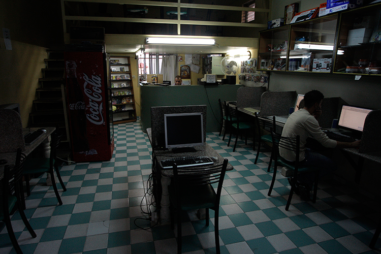In this November 2010 file photo, a man uses a computer in an internet cafe in the West Bank town of Bethlehem (AP/Nasser Shiyoukhi)