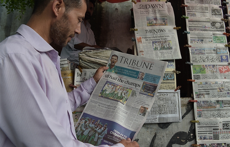 Newspapers at a stand in Islamabad in June 2017. A news crew in the city say students attacked them and damaged their vehicle this week. (AFP/Aamir Qureshi)
