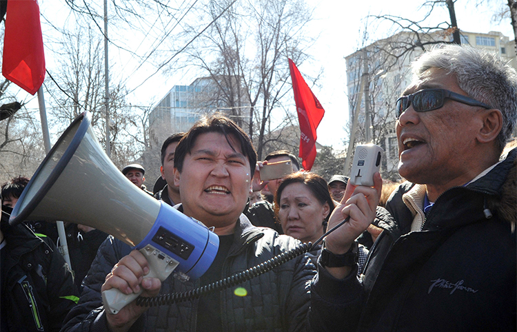 Supporters of detained opposition politician Omurbek Tekebayev protest in the Kyrgyzstan's capital Bishkek, in February. A media group that reported on comments by Tekebayev is facing five separate charges of insulting the president. (AFP/Vyacheslav Oseledko)