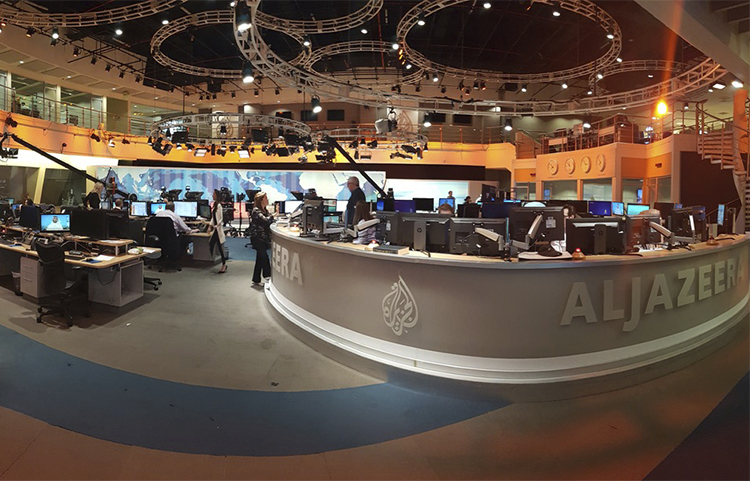 Al-Jazeera staff at the broadcaster's Doha headquarters in June 2017. Qatar's neighbors have demanded the country close the station as part of negotiations in the current political crisis. (AP/Malak Harb)