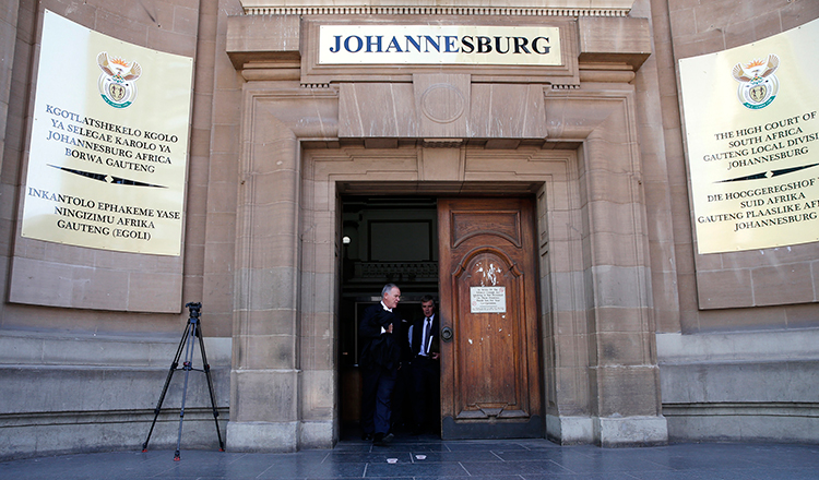 Lawyers leave the Johannesburg High Court in this March 2015 file photograph. (Reuters/Siphiwe Sibeko)