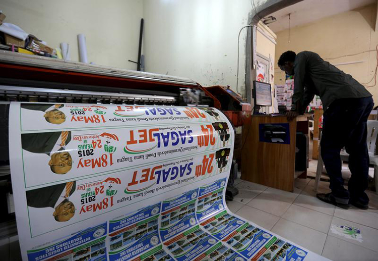 In this May 16, 2015, file photo, a printer prepares materials to commemorate the anniversary of Somaliland's declaration of independence from Somalia. (Reuters/Feisal Omar)