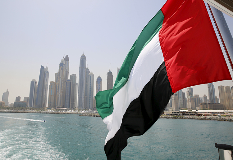 In this May 22, 2015, file photo, the flag of the United Arab Emirates flies over a boat in the Dubai Marina. (Reuters/Ahmed Jadallah)