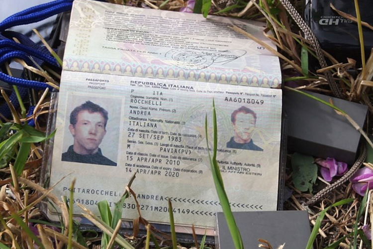 Andrea Rocchelli's passport is photographed on May 25, 2014, the day after his death. (AFP)