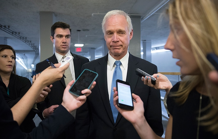 Sen. Ron Johnson, Republican of Wisconsin, center, speaks to journalists in Washington, D.C. on June 27. He released a report claiming that media leaks under the Trump Administration harm U.S. national security. (AP/J. Scott Applewhite)