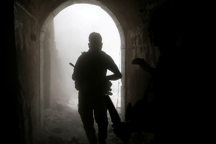An Iraqi soldier looks for cover after a grenade explosion in the old city of Mosul, July 4, 2017. (Reuters/Ahmed Jadallah)