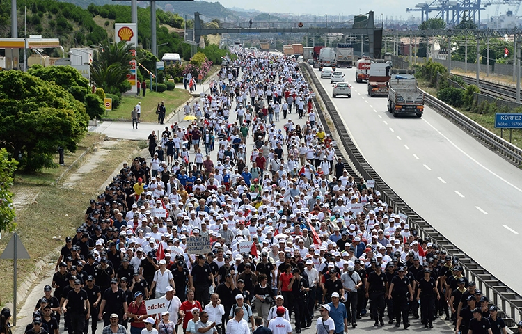 "Thousands of opposition supporters pass through Izmit, Turkey, on the 21st day of a 425-kilometer (265-mile) ""march for justice"" to protest the jailing of opposition member of parliament and former editor Enis Berberoğlu."
