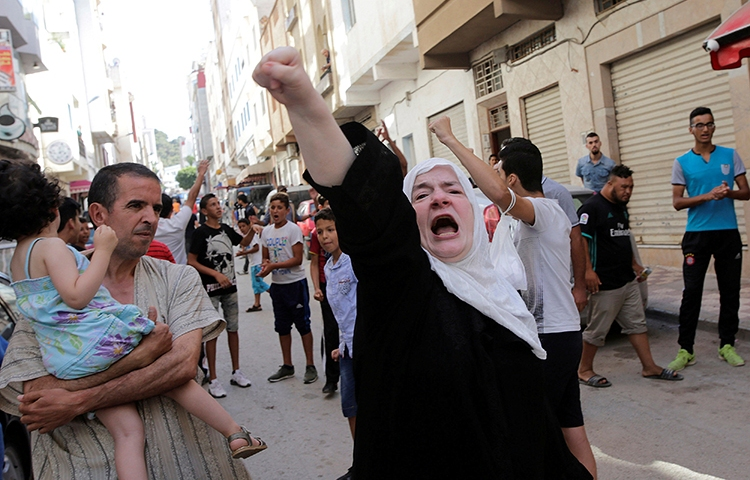A woman shouts slogans in a protest in the Moroccan town of Al-Hoceima, July 21, 2017. (Reuters/Youssef Boudlal)