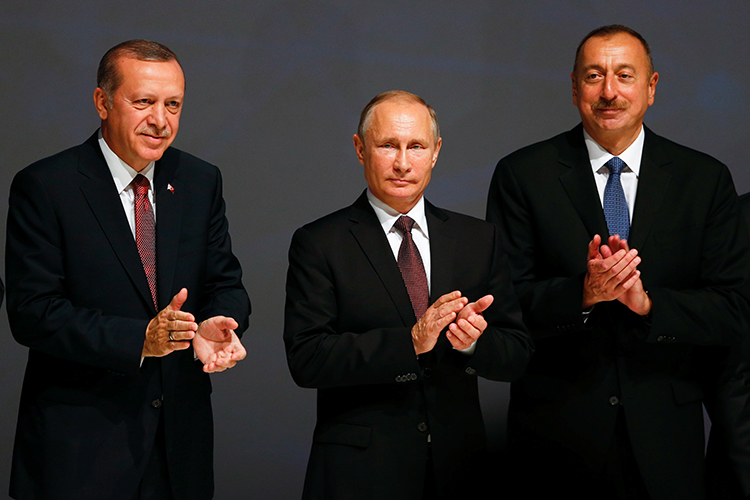 Azerbaijani President Ilham Aliyev (right) stands with Turkish President Recep Tayyip Erdoğan (left), and Russian President Vladimir Putin at an energy summit in Istanbul, October 10, 2016. (Reuters/Murad Sezer)