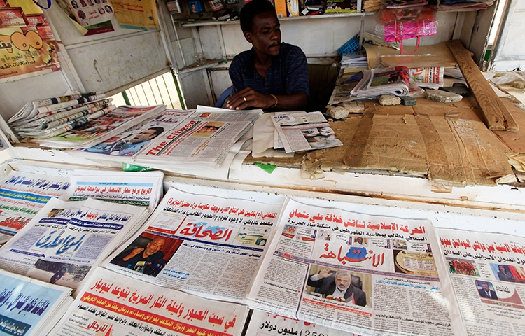 A November 13, 2015, file photo shows newspapers on display at a newsstand in Khartoum. (Reuters/Mohamed Noureldin Abdallah)