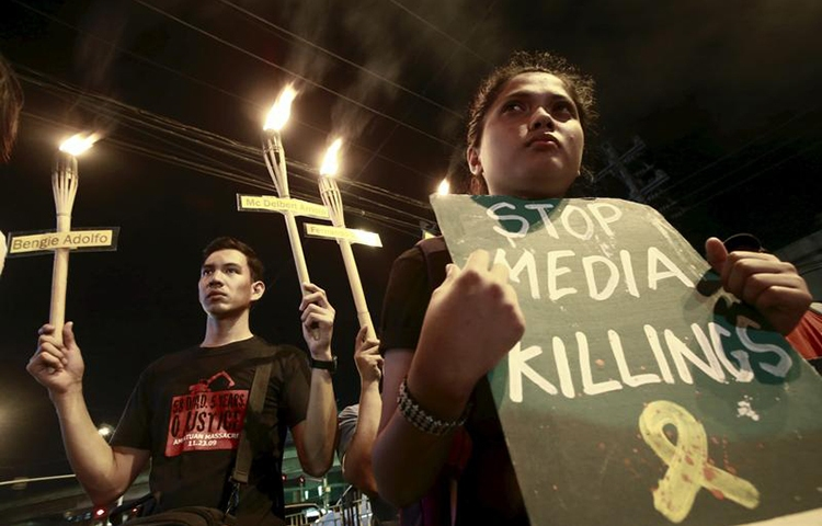 In this November 23, 2015, file photo, relatives of journalists killed march in Manila to commemorate their deaths and to demand justice. (Reuters/Romeo Ranoco)