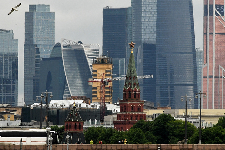 Tourists take photos of the Moscow skyline. A journalist based in the city says he has received anonymous threatening text messages over his reporting. (AFP/Kirill Kudryavtsev)
