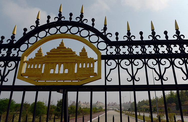 Gate's leading to Myanmar's parliament in Naypyidaw. The Upper House is due to discuss amendments to Myanmar's restrictive Telecommunications Law this week. (AFP/Romeo Gacad)