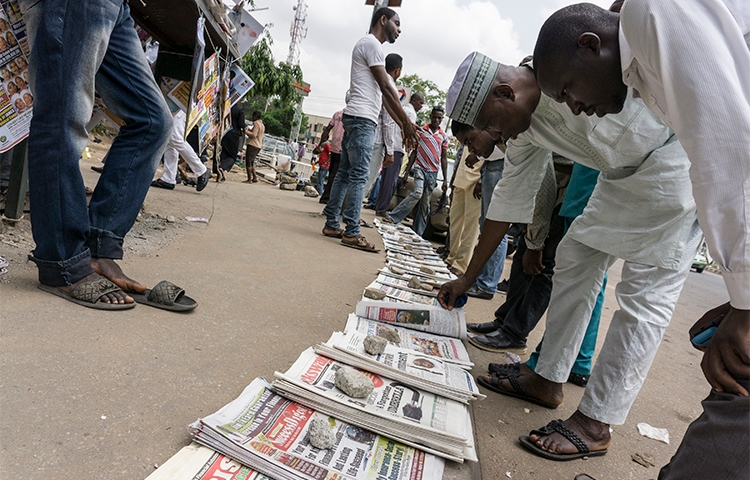 Newspapers are sold on the street in Abuja, Nigeria, in May. Nigerian police raided the offices of one of the country's daily newspapers in June over a long-standing legal dispute. (AFP/Stefan Heunis)