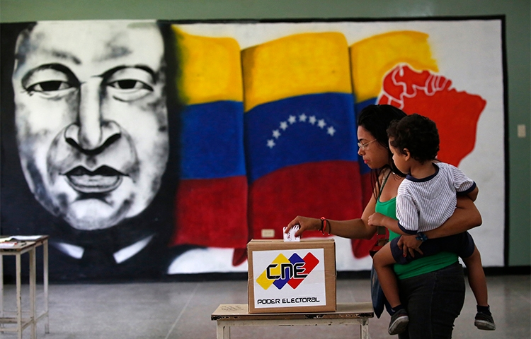 A woman casts her vote at a polling station during the Constituent Assembly election in Caracas on July 30. Journalists covering the vote and unrest in Venezuela have been arbitrarily detained, attacked, and threatened. (Reuters/Carlos Garcia Rawlins)