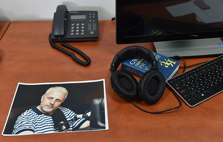 A photo of Pavel Sheremet on his desk at the Radio Vesti offices. Colleagues say his unsolved murder has made journalists in Ukraine wary. (AFP/Sergei Supinksky)