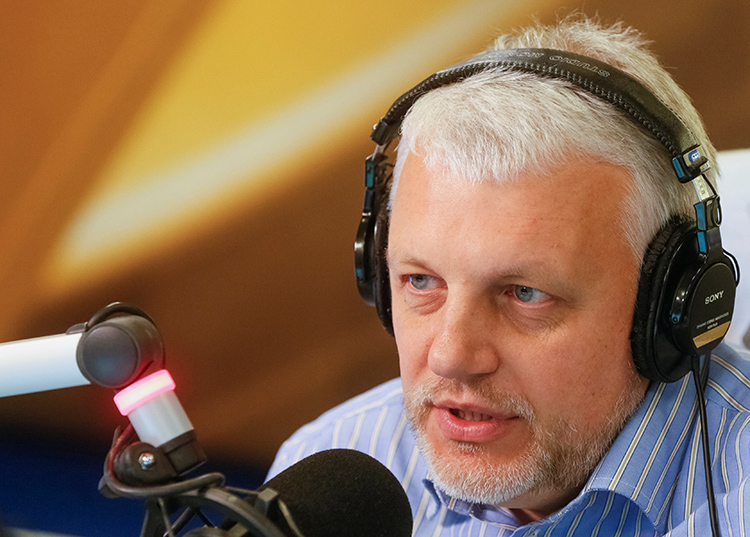 Pavel Sheremet talks on air at a Kiev radio station in 2015. The journalist's career spanned print, radio, and TV in Belarus, Russia, and Ukraine. (Reuters/Valentyn Ogirenko)