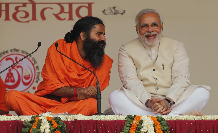 Narendra Modi, then prime ministerial candidate for India's Bharatiya Janata Party, shares a moment with guru Baba Ramdev (left) in New Delhi, March 23, 2014. (Reuters/Adnan Abidi)