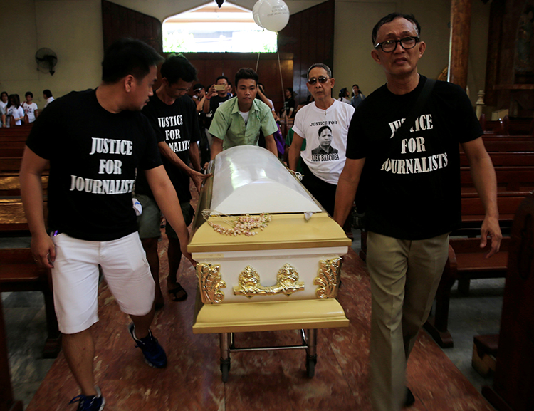 The Philippines ranks fourth on CPJ's most recent global Impunity Index, a measure of countries where journalists are killed and their murderers go free. Here, Filipino journalists escort the coffin of slain news reporter Alex Balcoba during his funeral in Manila, June 1, 2016. (Reuters/Romeo Ranoco)