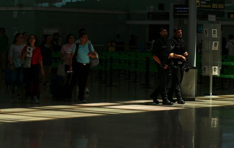 Police patrol Barcelona-El Prat airport on June 13, 2017. (Reuters/Albert Gea)