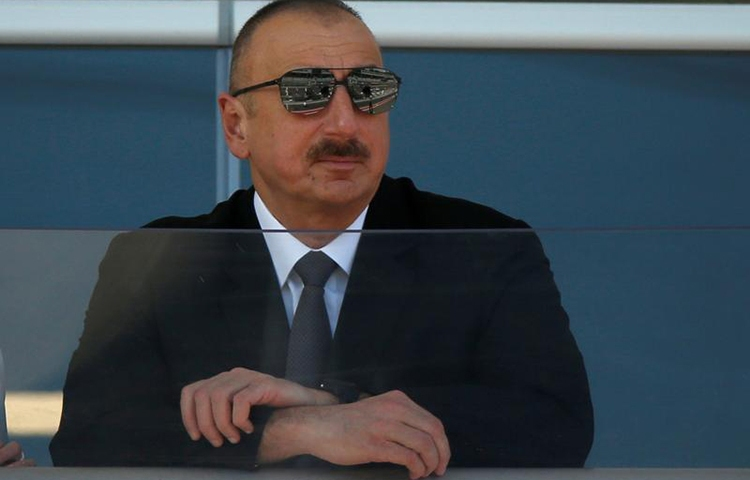 Azerbaijani President Ilham Aliyev, shown here watching a parade before a Formula 1 race in Baku, June 25, 2017, has maintained strict control over the media over the course of his 14-year rule. (Reuters/David Mdzinarishvili)