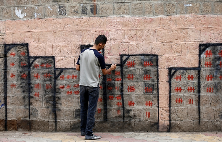 Artist and activist Thiyazen al-Alawi paints a mural on a wall of a hospital in Sanaa as part of a cholera-awareness campaign. In one of the biggest outbreaks of the disease in modern history, more than 425,000 people in Yemen have contracted cholera, nearly 2,000 of whom have died, since the Saudi-led coalition began bombing the country in 2015. (REUTERS/Khaled Abdullah)