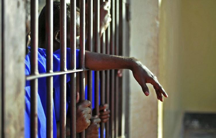 Prisoners stand behind bars in Garowe, Puntland, December 14, 2016. (AFP/Mohamed Abdiwahab)