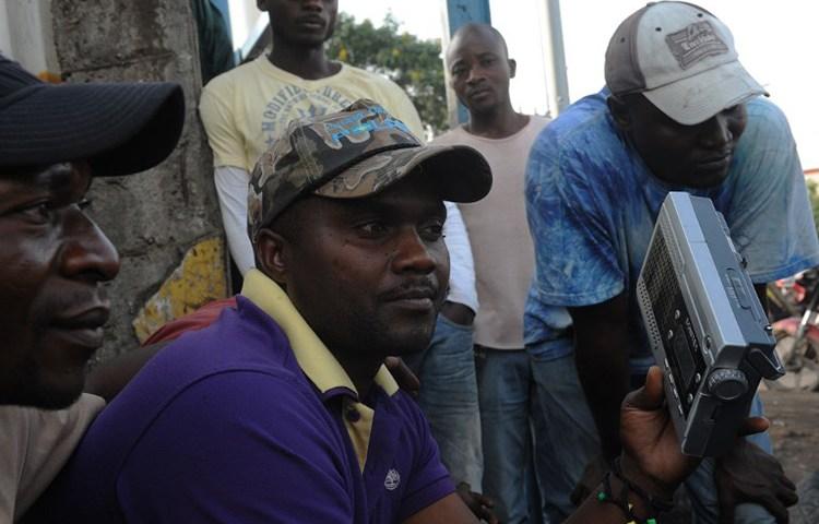 Congolese men listen to the radio in Goma, Democratic Republic of the Congo, December 11, 2011. (AFP/Simon Maina)