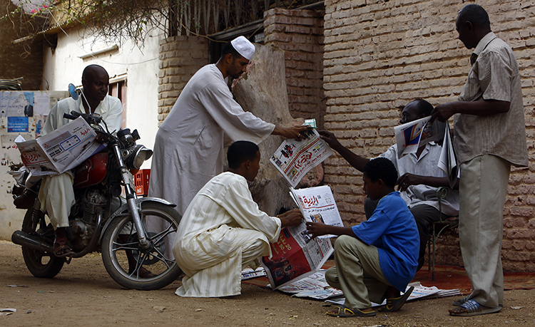 A newspaper street vendor outside the capital, Khartoum, in 2015. Sudan has fined a journalist over her critical column on the police. (AFP/Ashraf Shazly)