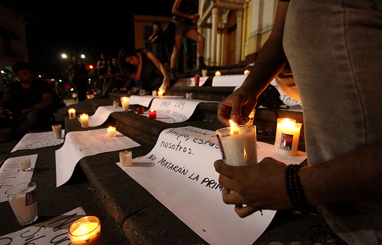 Journalists hold a late night vigil on August 1, 2015 to protest against the latest murder of a fellow journalist in Veracruz, Mexico. Mexico is one of the most dangerous countries in the world for journalists, according to CPJ research.(AP Photo/Felix Marquez)