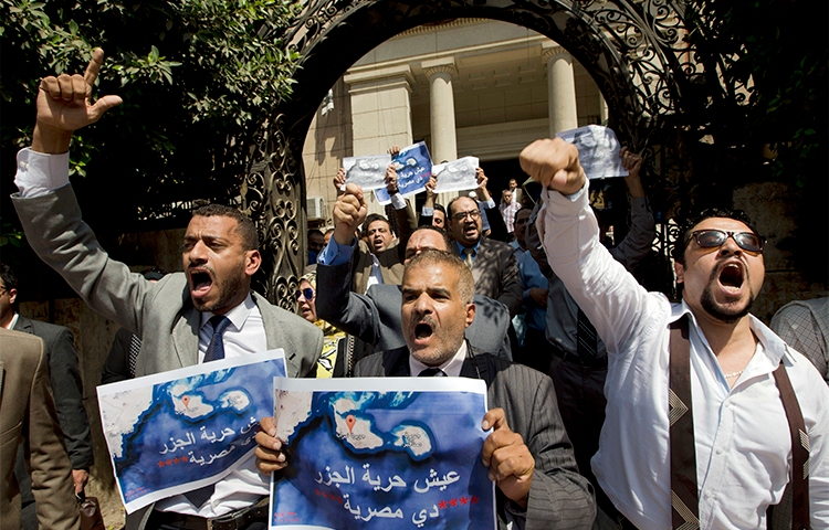 Dozens of Egyptians shout slogans during a protest in Cairo against an accord to hand over control of two Red Sea islands to Saudi Arabia. Journalist Hany Salah el-Deen is arrested on accusations of 'inciting protests.' (AP/Amr Nabil)