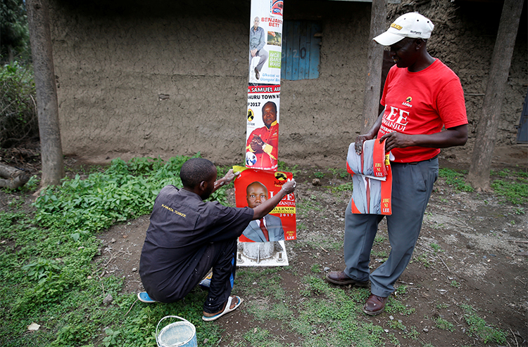 Campaign posters for local candidates are attached to pole in Nakuru. Several journalists say they have been threatened or attacked while covering the run up to Kenya's August 8 elections. (Reuters/Baz Ratner)